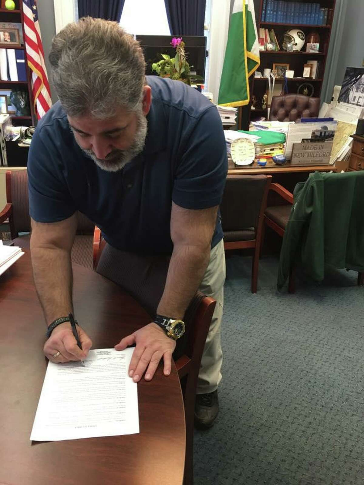 New Milford Mayor Pete Bass signing an emergency order in March suspending short-term lodging in New Milford until June 16.