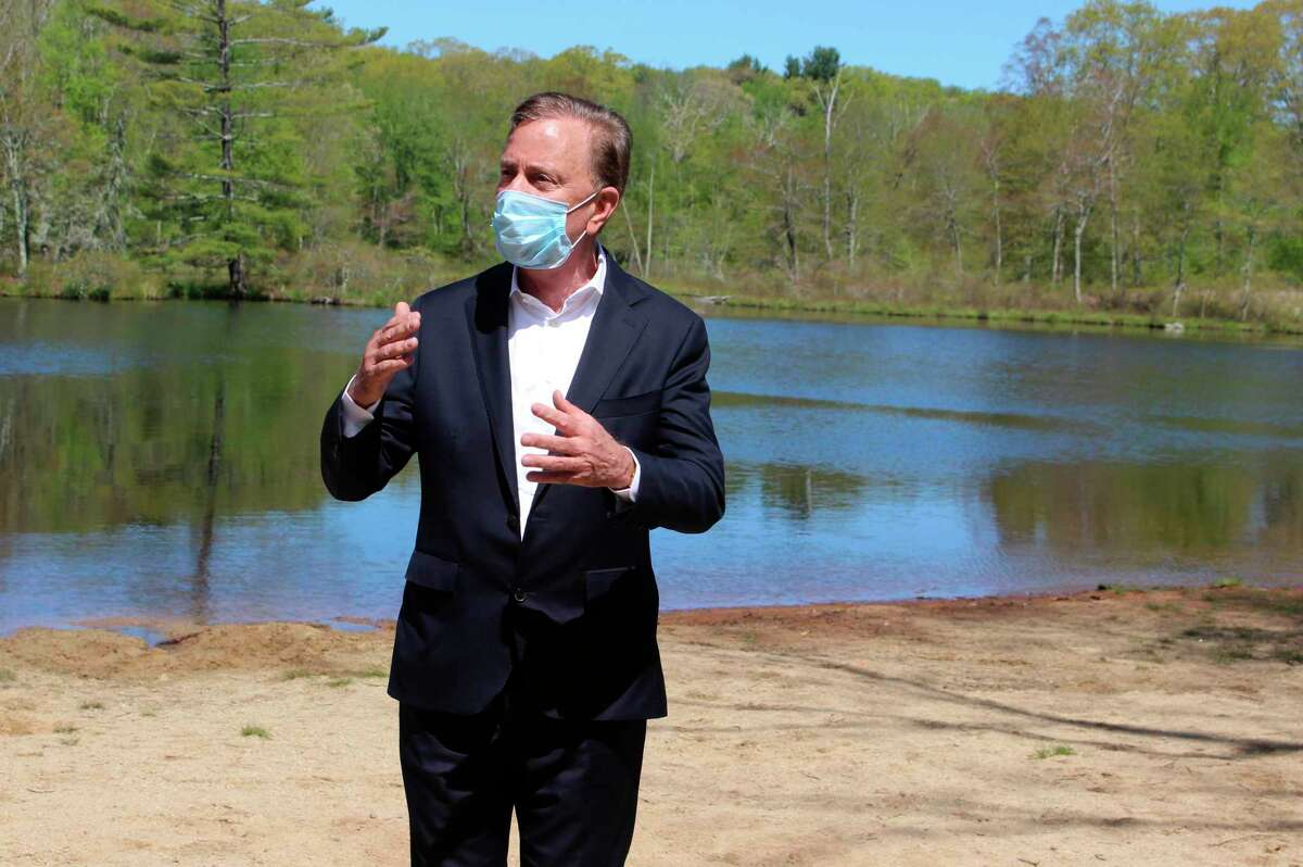 Connecticut Gov. Ned Lamont speaks to reporters at Gay City State Park in Hebron, Conn., on Thursday, May 21, 2020. The governor held his daily COVID-19 briefing for the media at the park in advance of the Memorial Day weekend.
