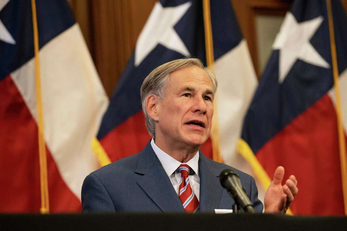 Texas Governor Greg Abbott announces the reopening of more Texas businesses during the COVID-19 pandemic at a press conference at the Texas State Capitol in Austin on Monday, May 18, 2020. The CEO of a technology company that has been entrusted with state contact tracing efforts for Texans exposed to the coronavirus has claimed a doctorate he never got, according to a Houston-based podcast.