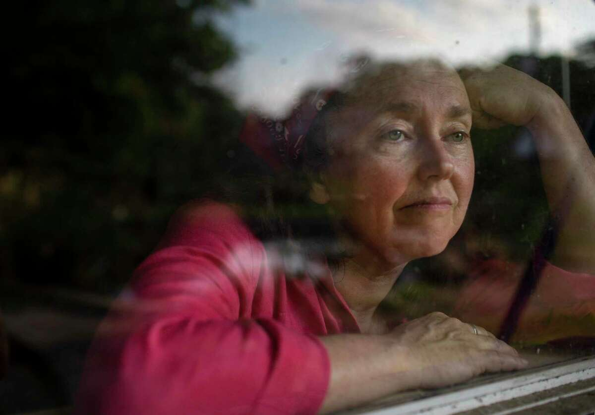 Houston Chronicle reporter Lisa Gray poses for a portrait at her home Thursday, March 26, 2020, in Houston.