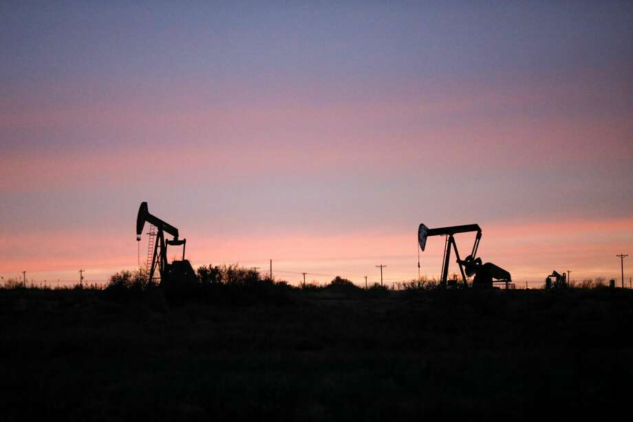 Pumpjacks at sunset photographed March 2, 2020 near Loving, New Mexico, in the Permian Basin. MANDATORY CREDIT: The Oilfield Photographer, Inc. Photo: James Durbin / The Oilfield Phot/The Oilfield Photographer, Inc. / © All Rights Reserved