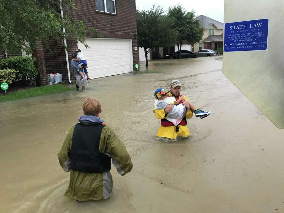 Spring firefighters assist residents during Hurricane Harvey Photo: Courtesy Of Spring Fire Department