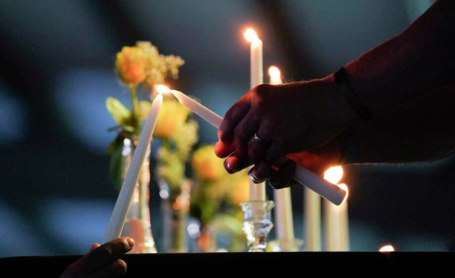 Candles were lit for each of the victims in honor of the one-year anniversary of the Santa Fe High School shooting on Saturday, May 18, 2019 in Hitchcock. This year, an in-person event at the school was not possible due to the coronavirus. Photo: Elizabeth Conley, Houston Chronicle / Staff Photographer / © 2018 Houston Chronicle