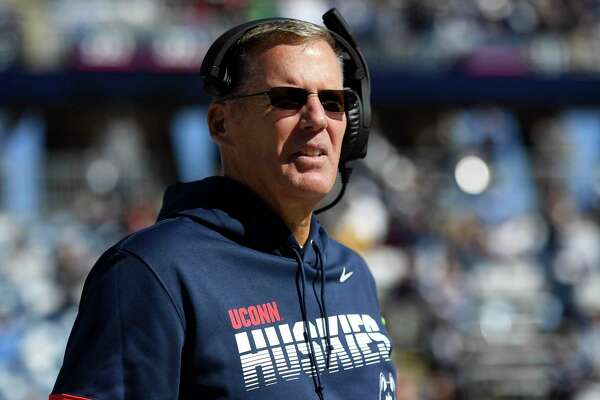 UConn football coach Randy Edsall walks the sidelines during an October game against Houston in East Hartford. The football program lost $13.3 million last season.