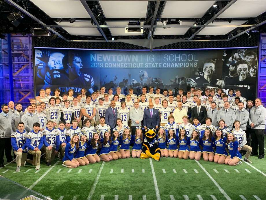 Members of the Newtown football team appeared at halftime of NBC's Sunday Night Football program in December. The Newtown, Pomperaug, Barlow and New Milford football programs are raising money to help health-care workers. Photo: Submitted / NBC Sports
