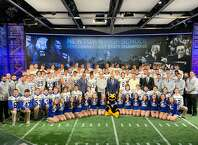 Members of the Newtown football team appeared at halftime of NBC's Sunday Night Football program in December. The Newtown, Pomperaug, Barlow and New Milford football programs are raising money to help health-care workers.