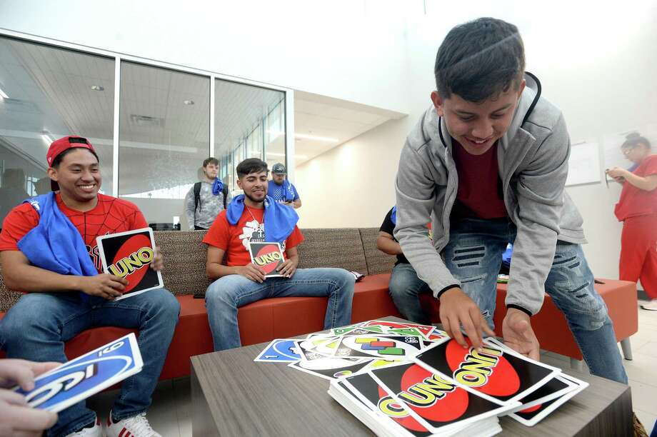 From left, Felipe Rodriguez, Luis Rosales and David Moreno enjoy a game of Uno Tuesday afternoon. In observance of National Student Appreciation Day, Lamar Institute of Technology held a student appreciation event with Chick-fil-A, snacks and oversized games at the Eagle's Nest. Photo taken Tuesday, March 10, 2020 Kim Brent/The Enterprise Photo: Kim Brent / The Enterprise / BEN