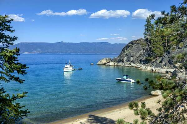 """D.L. Bliss State Park, SOUTH LAKE TAHOE, CA """"u2013 December 29, 2015: An image of D.L. Bliss State park cove where recreational boats and paddle boarders can take advantage of secluded coves and sunny beaches."""