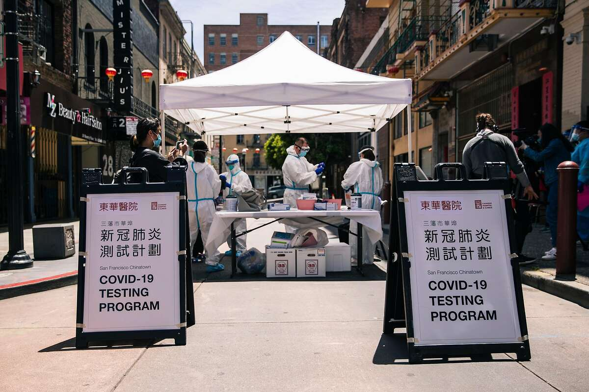 Health workers from the Chinese Hospital work to test residents of the Hoy Sun Ning Yung Benevolent Association on Chinatown's Waverly Place for the COVID-19 coronavirus disease in San Francisco, Calif. on Friday, May 22, 2020.