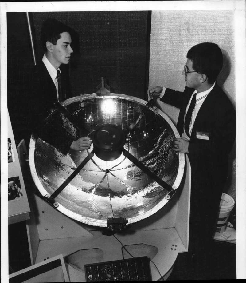 Plaza Convention Center, Albany, New York - David Bibighaus and David Scagrilli, both seniors at Shenendehowa High School, with their portable solar energy machine called the Solar Energy in a Suitcase. May 23, 1990 (Skip Dickstein/Times Union Archive) Photo: Skip Dickstein / Times Union