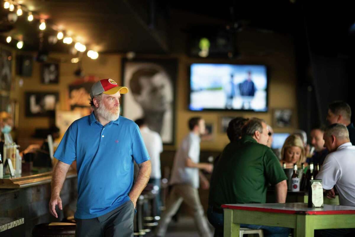 Customers visit Kirby Ice House as COVID-19 lockdown restrictions are eased for bars on Friday, May 22, 2020, in Houston.