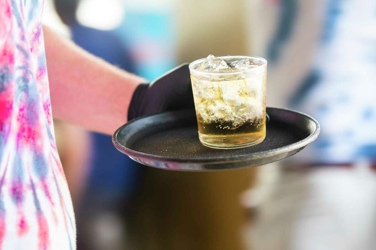 Server Josh Keating carries a drink, Friday, May 22, 2020, at Eight Row Flint in Houston.