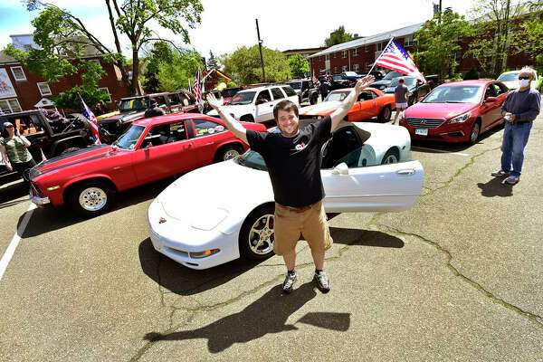 Kevin Ward of West Haven, in the parking lot of St. Lawrence School in West Haven on May 16, 2020, has organized many parades to celebrate birthdays and other people, such as first responders, as an alternative to social isolation quarantines during the coronavirus pandemic.