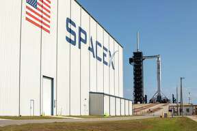 A SpaceX Falcon 9 rocket, with the Crew Dragon spacecraft atop, stands poised for launch at Launch Complex 39A at NASA's Kennedy Space Center in Florida on May 21, 2020, ahead of NASA and SpaceX's Demo-2 mission. The rocket and spacecraft will carry NASA astronauts Bob Behnken and Doug Hurley to the International Space Station as part of the agency's Commercial Crew Program. Launch is slated for 3:33 p.m. CDT on Wednesday, May 27.