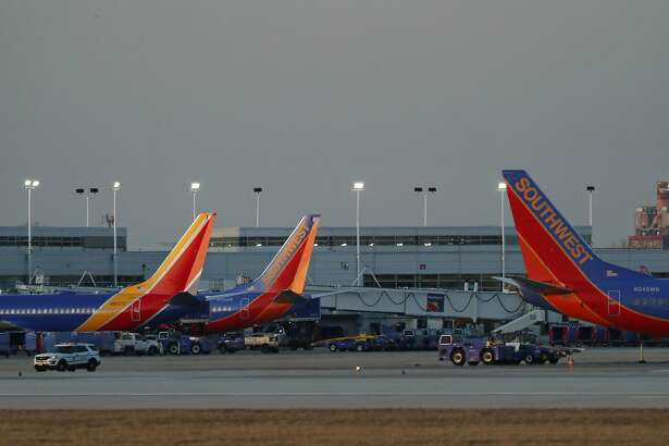 Southwest Airlines planes are parked at gates at Midway International Airport in Chicago on March 17, 2020. (John J. Kim/Chicago Tribune/TNS)