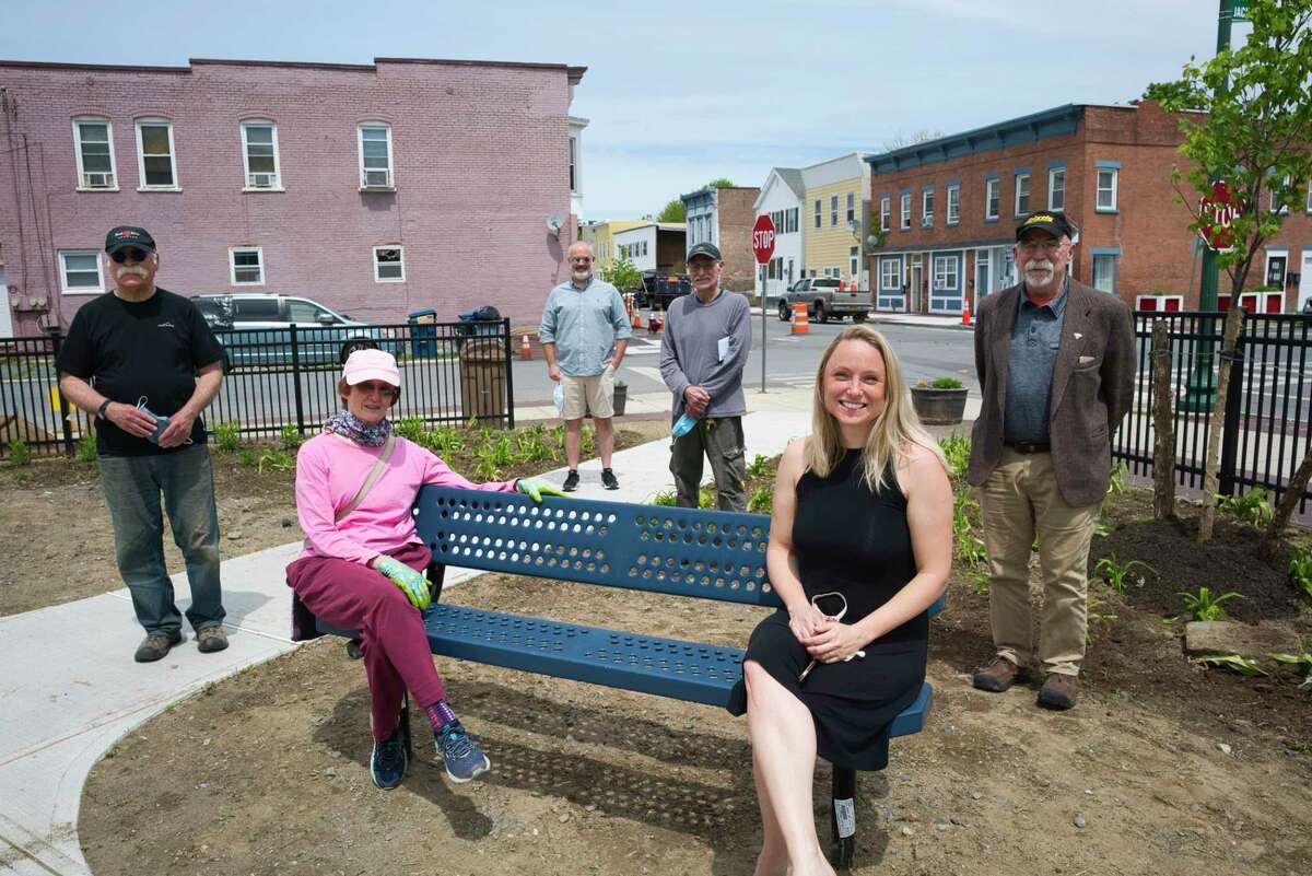 Members of the Osgood Neighborhood Association from left to right, Alan McClintock, Diane Bell, Chuck Conroy, Armando Soto, Emily Cooper-Kelley, and Stanley Hadsell, pose for a photo in the new park at the corner of 2nd St. and Jackson St. on Tuesday, May 19, 2020, in Troy, N.Y. Members of the association built the park. (Paul Buckowski/Times Union)
