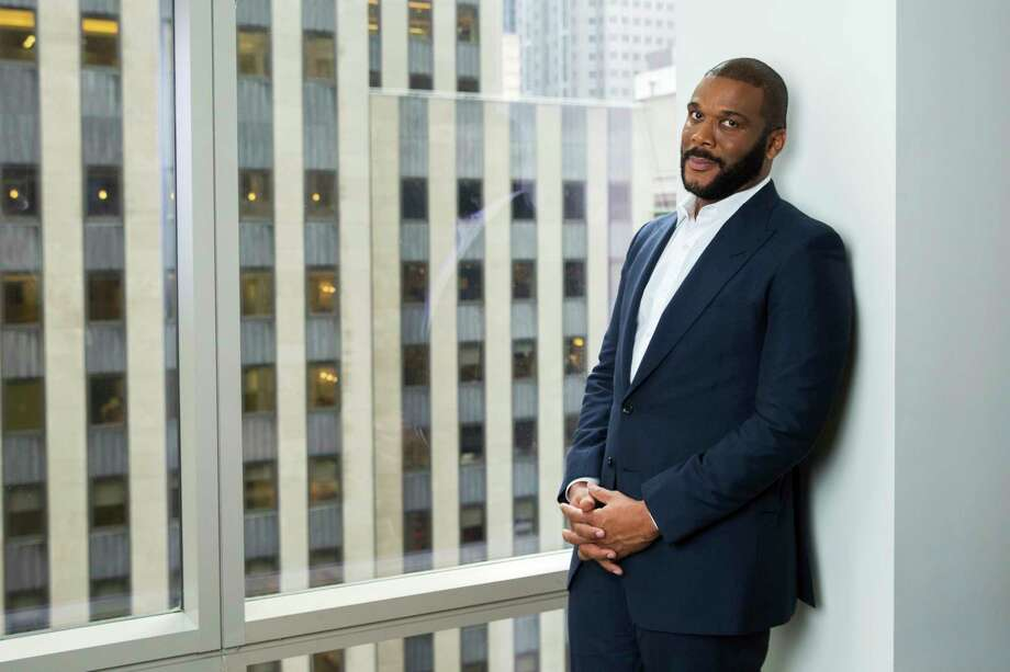 FILE - In this Nov. 16, 2017, file photo, actor-filmmaker and author Tyler Perry poses for a portrait in New York. Perry is looking to reopen his 330-acre Atlanta-based mega studio soon, but other studios in Georgia are anxiously waiting for Hollywood's green light to return back to work. Perry plans on restarting production at the Tyler Perry Studios complex in July, making it one of the first studios to domestically reopen after production was halted a few months ago to combat the spread of the coronavirus. (Photo by Amy Sussman/Invision/AP, File) Photo: Amy Sussman / 2017 Invision