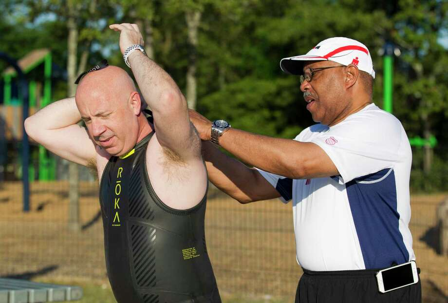 John Anthony Brown, board member with The Woodlands Township, puts on his wetsuit as triathletes prepare for the 2019 Ironman Triathlon competition at Northshore Park, Friday, April 26, 2019, in The Woodlands. A two-term incumbent, Brown became the second person to announce intention to seek a seat on The Woodlands Township Board of Directors, telling The Villager on Friday night he intends to seek his third term in office in the November 2020 election. Photo: Jason Fochtman, Houston Chronicle / Staff Photographer / © 2019 Houston Chronicle