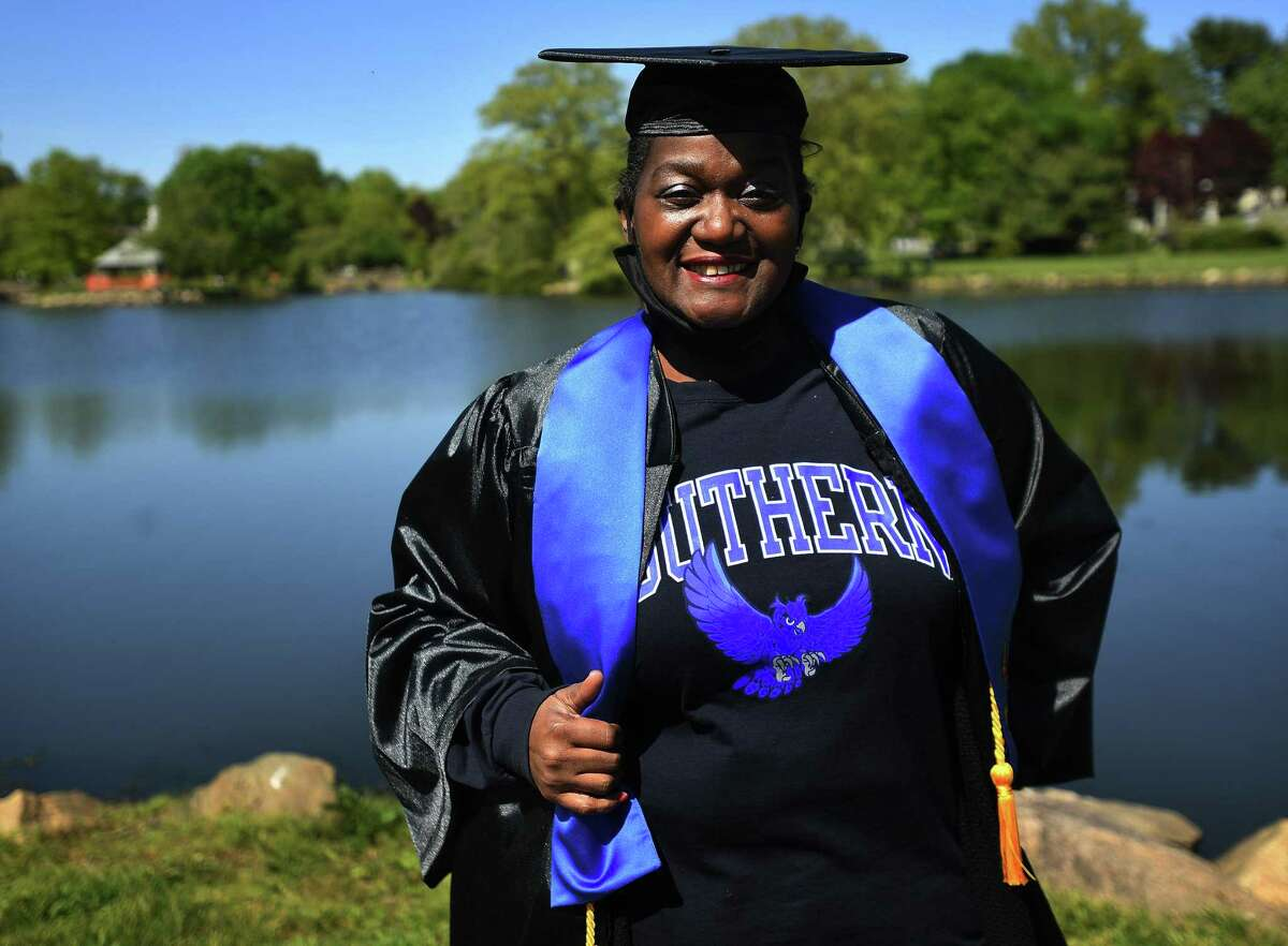 Nancy Green, 56, of Stamford, poses in her cap and gown for her graduation from Southern Connecticut University May 21, 2020. Green is recovering from a serious case of COVID-19 that threatened her life in March.