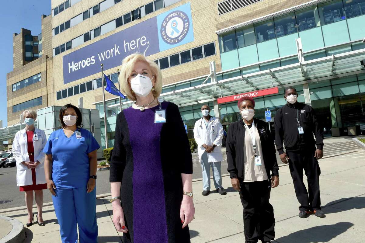 Cynthia Sparer, center, senior vice president for operations and executive director of Women's and Children's Services at Yale New Haven Hospital, is photographed outside of the Yale New Haven Hospital Emergency room with, from left, Dr. Elena Ratner, Patient Services Manager Camisha Taylor, Certified Nurse Mark Giles, and Mary Graham and Kevin Burgess of Environmental Services on May 21, 2020.