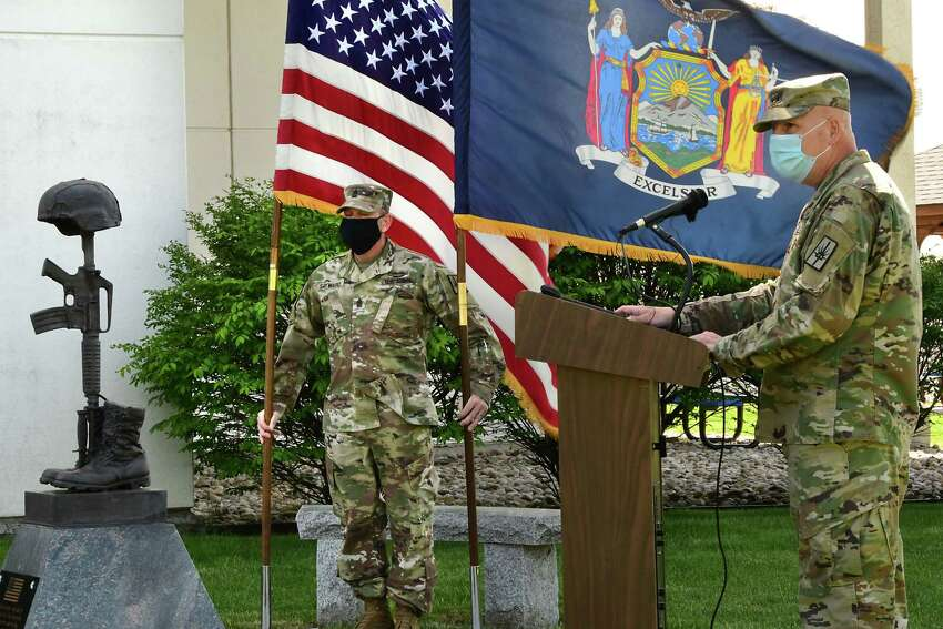 Major General Ray Shields, right, speaks during a traditional Memorial Day ceremony at New York State Division of Military and Naval Affairs Headquarters on Friday, May 22, 2020 in Latham, N.Y. Sergeant Major Roy Sayward is seen holding the United States and New York State flags. (Lori Van Buren/Times Union)