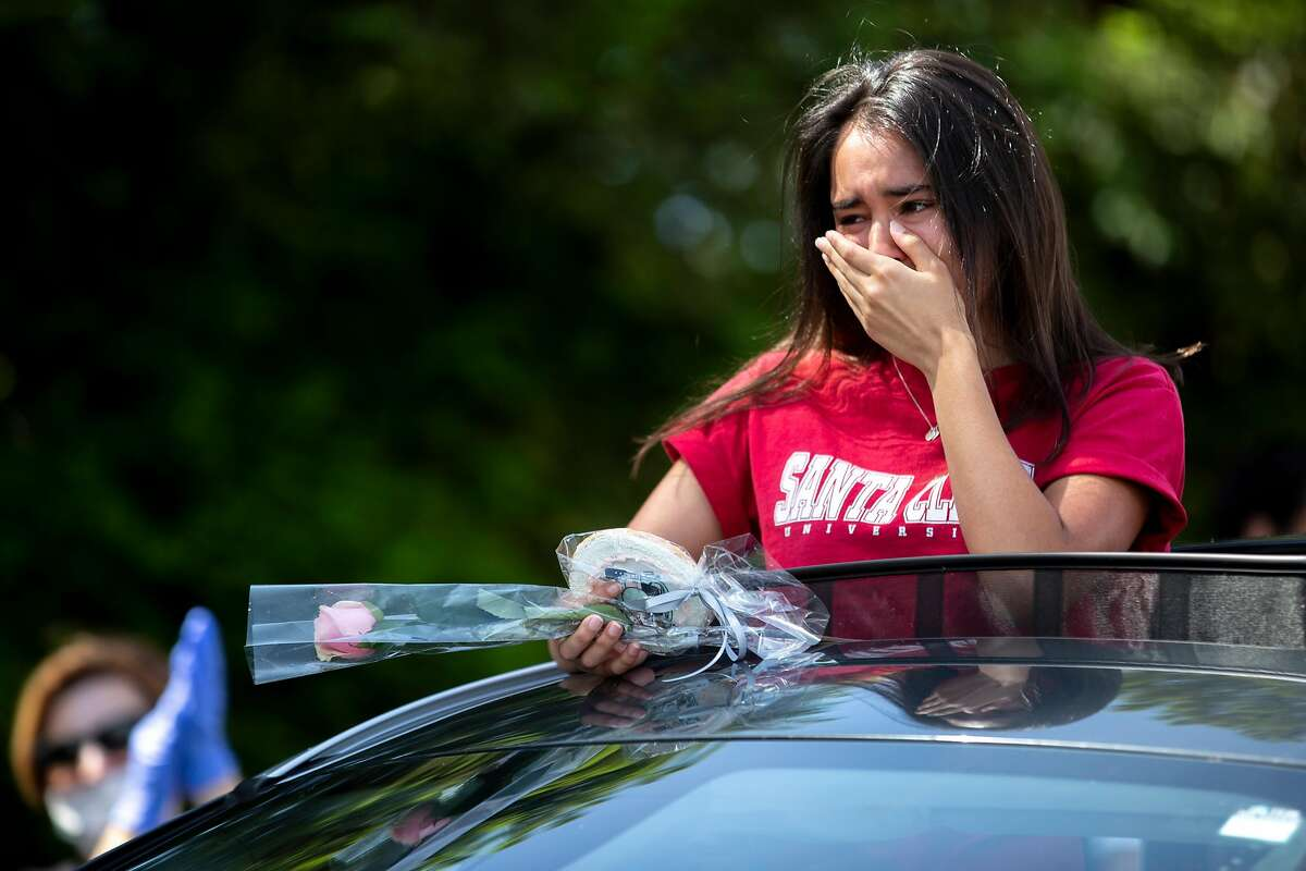 Emma Chappell is emotional as she nears the end of the parade at Carondelet High School on Saturday, May 16, 2020, in Concord, Calif. The all-girls private Catholic school hosted a drive-thru parade for their graduating class of 2020, amid the coronavirus pandemic.