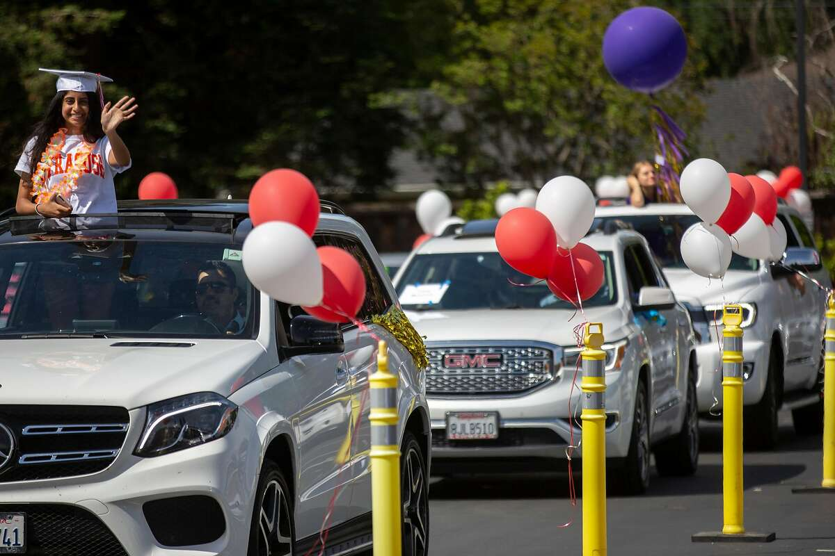 Ashima Dhawan waves during the parade at Carondelet High School on Saturday, May 16, 2020, in Concord, Calif. The all-girls private Catholic school hosted a drive-thru parade for their graduating class of 2020, amid the coronavirus pandemic.