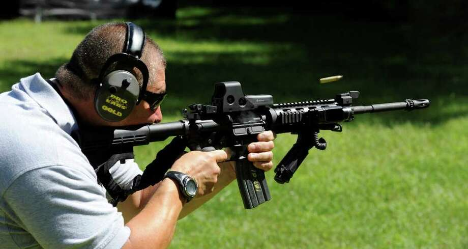 Schenectady County Sheriff's Office Training Supervisor John Affinito fires an AR15 rifle at a range in Pattersonville, New York August 20, 2010.   (Skip Dickstein/Times Union) Photo: Skip Dickstein / 2008