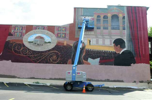 Muralist Kevin Clark works on a mural of the Troy Savings Bank Music Hall above the parking lot adjacent to the music hall and bank in Troy on Aug. 19, 2010.  (Lori Van Buren / Times Union) Photo: Lori Van Buren