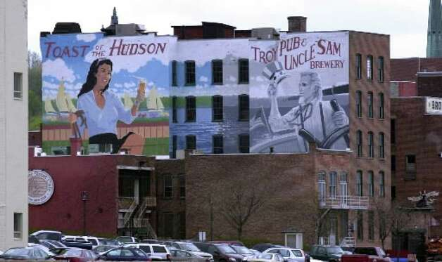 A mural painted on the side of the Troy Brew Pub as seen from the Hudson River. ( Times Union archive )