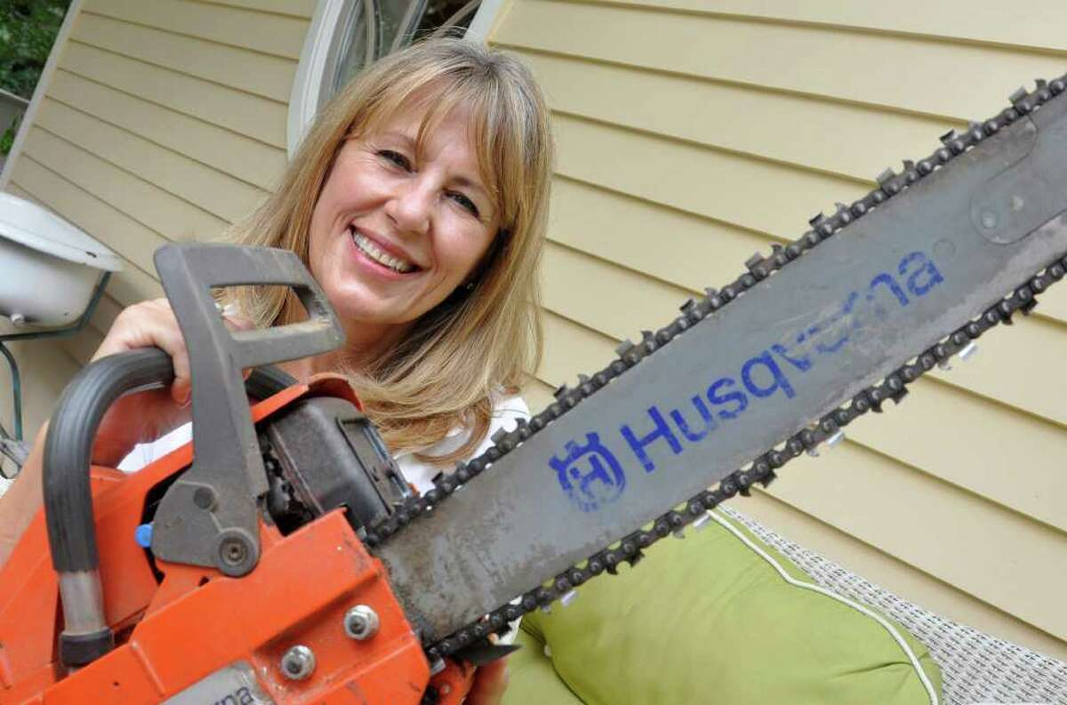 Natalie Gustafson, an Emmy award-winning Greenwich resident has a documentary about an ice-sculpting competition in Alaska premiering on Monday evening, Aug. 23, on TLC. Natalie Gustafson is pictured at home with the ice-scuplting tool of choice, a chainsaw.