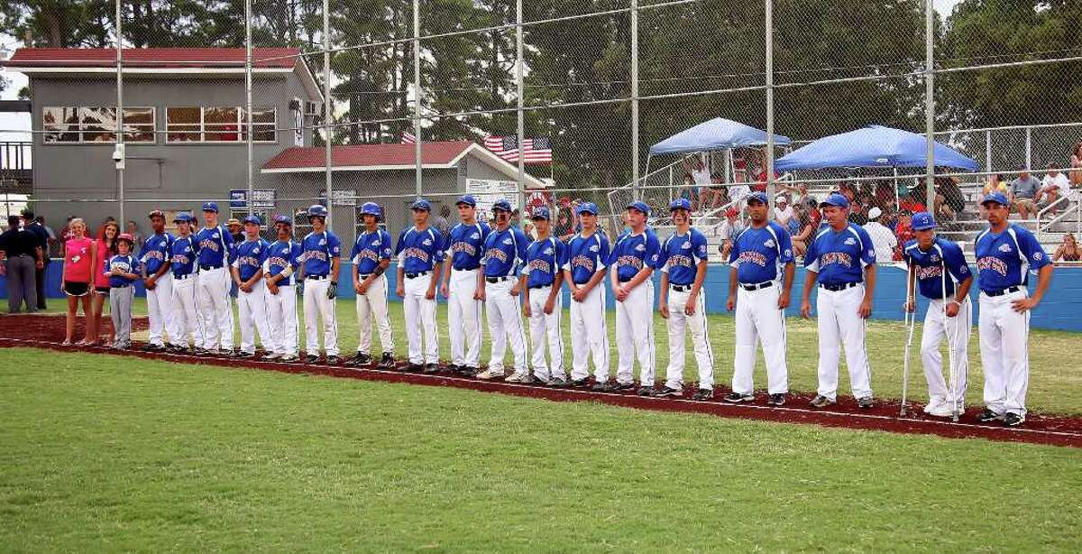 Stamford players and coaches line up for the start of the Babe Ruth World Series game at Burlington Field in Monticello, Arkansa on Sunday August 22, 2010. The game went into a rian delay before the first pitch was thrown.