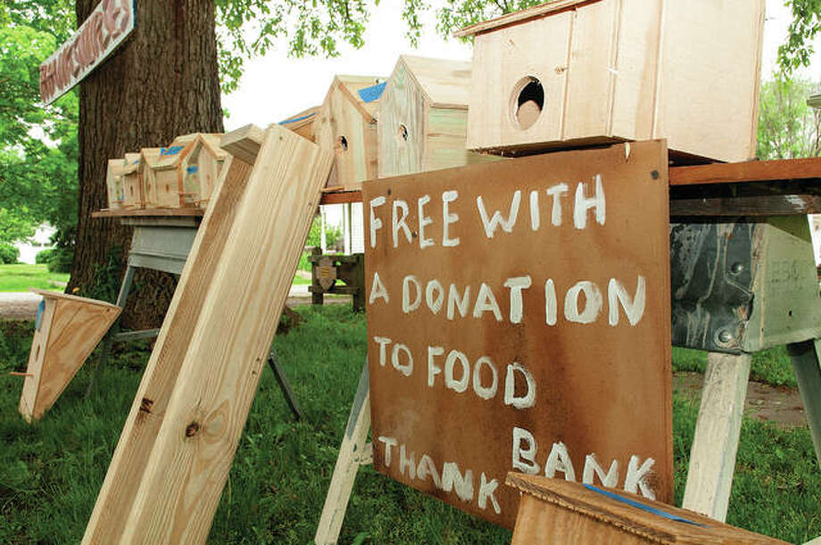 Chip Williams has been building birdhouses at his Elm Street home and giving them away free with the understanding that people who take them will donate to the Jacksonville Food Bank. Williams has made 52 birdhouses since the COVID-19 pandemic caused closures in Illinois.