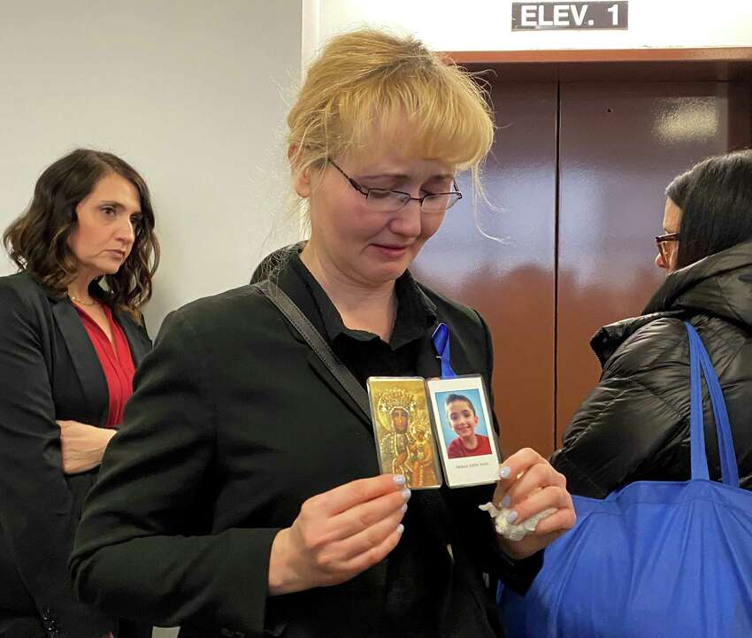 Riverhead, N.Y.: Justyna Zubko-Valva is pictured with a photo of her son Thomas Valva at the Arthur M. Cromarty Criminal Court Complex in Riverhead, New York on Feb. 6, 2020. Thomas Valva's father, Michael Valva, and his father's girlfriend, Angela Pollina, were arrested on Jan. 24, 2020. They were charged with second-degree murder of Thomas Valva, 8 years-old.