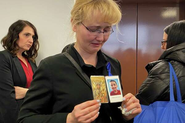 Riverhead, N.Y.: Justyna Zubko-Valva is pictured with a photo of her son Thomas Valva at the Arthur M. Cromarty Criminal Court Complex in Riverhead, New York on Feb. 6, 2020. Thomas Valva's father, Michael Valva, and his father's girlfriend, Angela Pollina, were arrested on Jan. 24, 2020. They are charged with second-degree murder of Thomas Valva, 8 years-old.