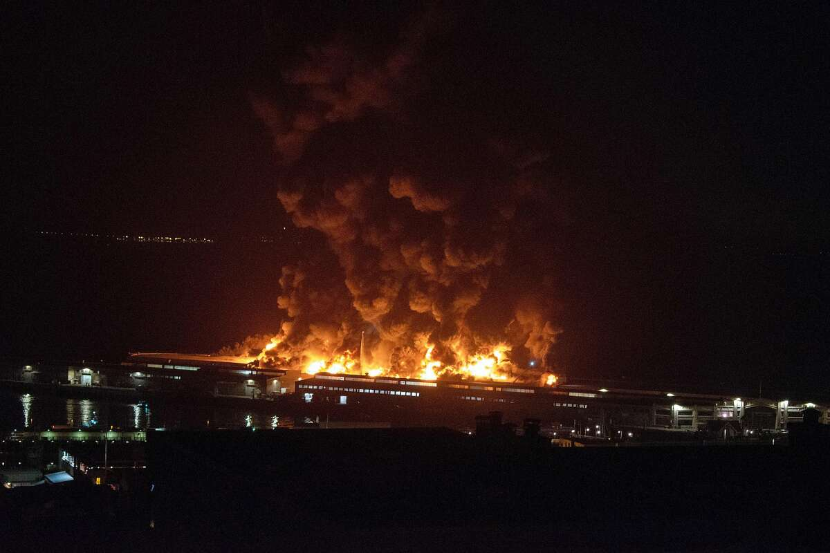 A warehouse fire burns at Pier 45 in San Francisco on Saturday.