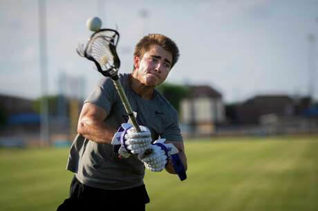 Jacob Magelssen, 19, former lacrosse player at Kinkaid and currently a student at Furman University practices in Houston on Friday, May 22, 2020. Furman University discontinued the institution's men's lacrosse programs immediately leaving Magelssen without a team. Magelssen said the university will honor the scholarships of current student athletes in men's lacrosse.