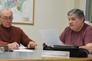 P&Z member Mark Widomski, right, discusses ways to revise the Planned Development District rules during the Feb. 19 special meeting, with member Charles Kelly at left.