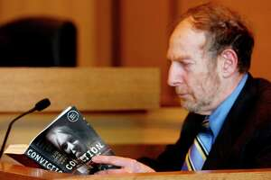 "Author Len Levitt reads an excerpt of his book ""Conviction"" in Superior Court in Stamford in April 2007. Levitt died at age 79 in his Stamford, Conn., home in May 18, 2020."
