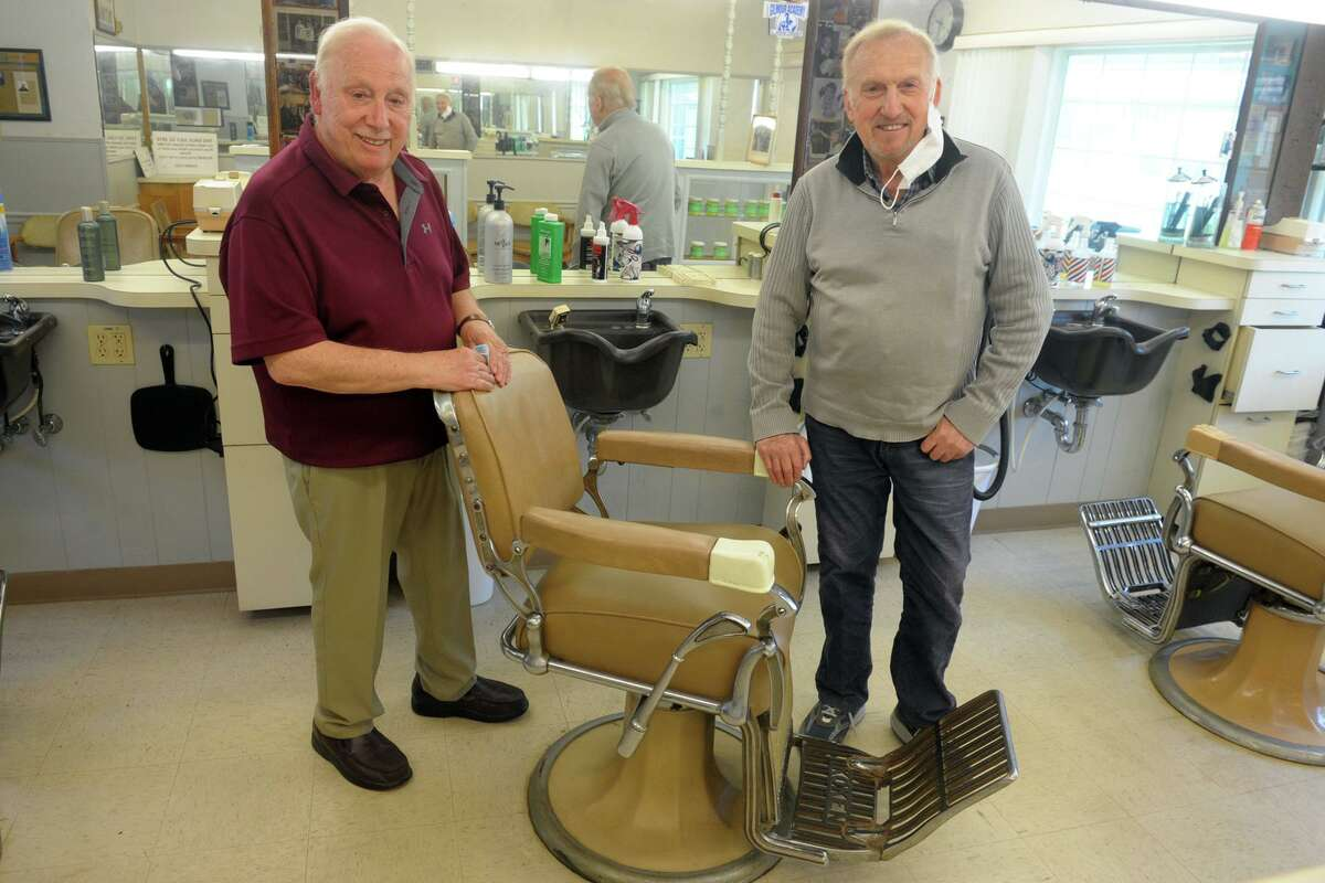 Brothers Tony, left, and Nick Clericuzio pose during an interview at Long Hill Hair Stylists, their barber shop in Trumbull, Conn. May 21, 2020. After 60-years in business, the brothers have both decided to retire.