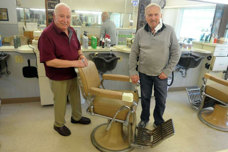 Brothers Tony, left, and Nick Clericuzio pose during an interview at Long Hill Hair Stylists, their barber shop in Trumbull, Conn. May 21, 2020. After 60-years in business, the brothers have both decided to retire. Photo: Ned Gerard / Hearst Connecticut Media / Connecticut Post