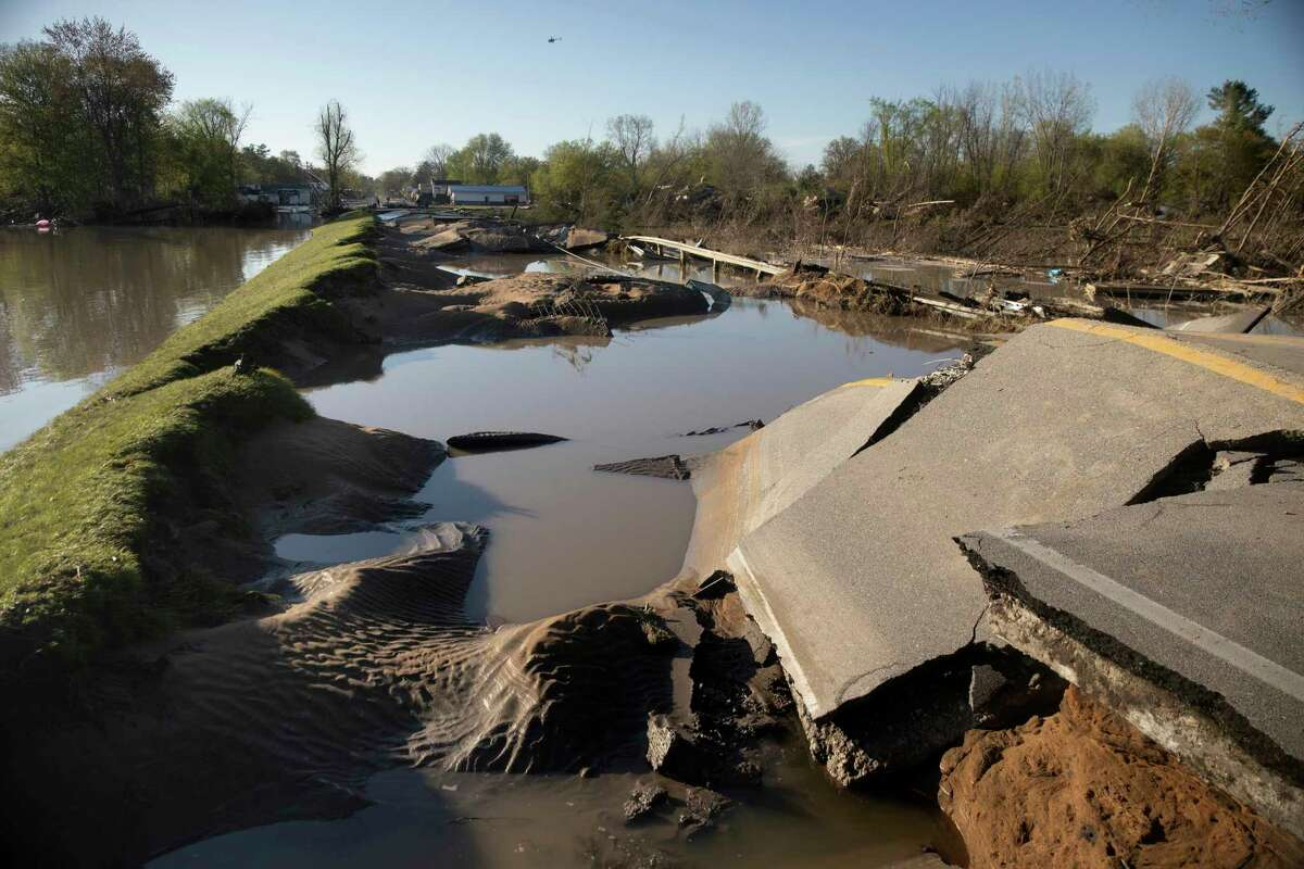 Saginaw Road in Sanford, Mich., pictured on Thursday, May 21, 2020. A section of the road washed away due to dam failures at Wixom Lake. (Neil Blake/The Grand Rapids Press via AP)