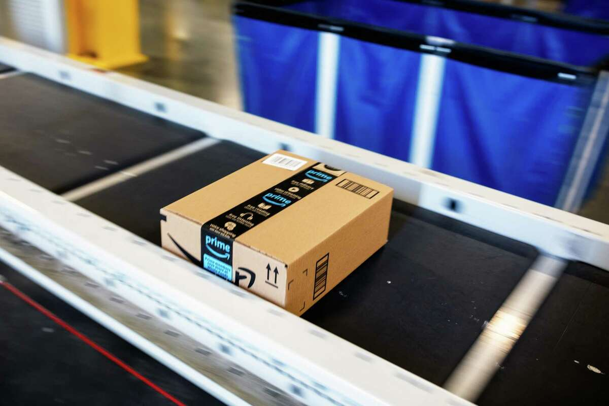 FILE -- A package on a conveyer belt at an Amazon warehouse in Carteret, N.J., on Oct. 18, 2018. After losing some online shoppers to rivals during the coronavirus pandemic, the retail giant is turning back to faster shipping times and big sales. (Demetrius Freeman/The New York Times)