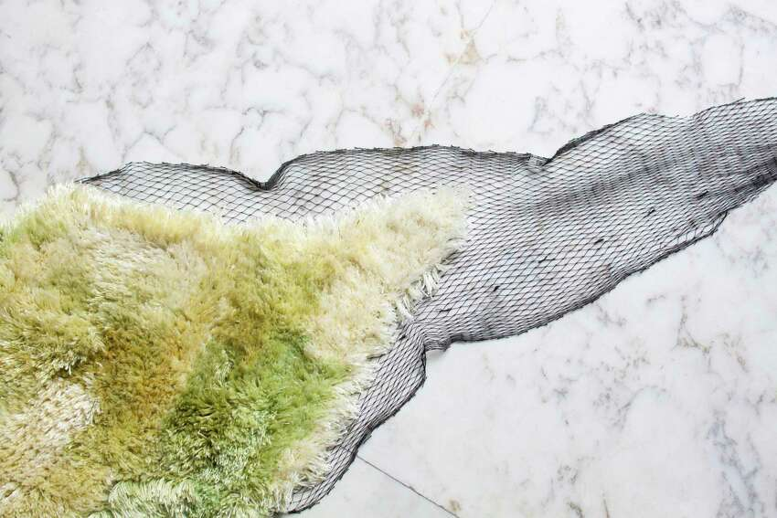 One of the rugs which Dutch designer Nienke Hoogvliet weaves abundantly-available seaweed into rugs, chairs and tables in her Sea Me Collection. Many manufacturers of home decor are working on producing sustainable products. Plant-based materials now include things like bark, leaves and seeds transformed into vegan leather, fabric and organic plastic. (Nienke Hoogvliet via AP)