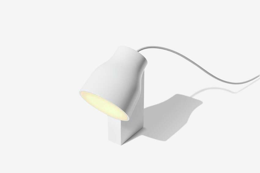 One of Gantri's lamps made from PLA, a product the San Francisco-based Gantri makes which processes corn kernels into a biodegradable thermoplastic fiber that can then be formed into a sturdy vegan plastic. The material can be treated in different ways, so it's translucent or opaque; Gantri is currently making contemporary wall, floor and table fixtures, like the light shown here. Many manufacturers of home decor are working on producing sustainable products. Plant-based materials now include things like bark, leaves and seeds transformed into vegan leather, fabric and organic plastic. (Gantri via AP)