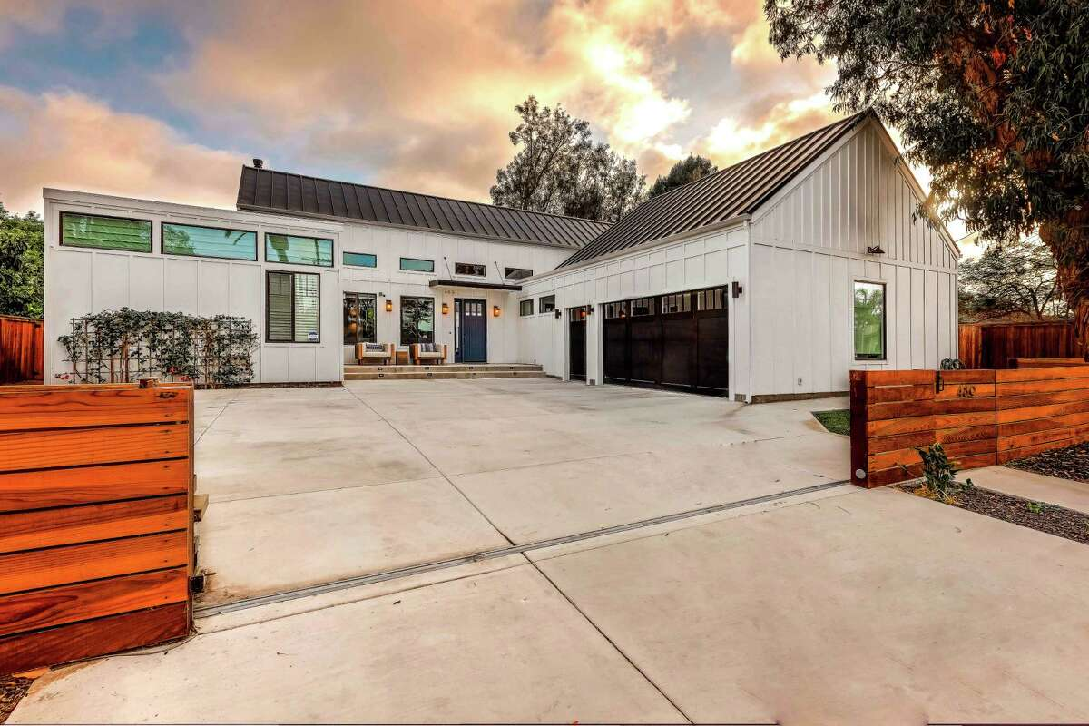HGTV star Tarek El Moussa and new girlfriend Heather Rae Young cleaned up in the sale of their Costa Mesa home, which sold for $130,000 over asking. The modern farmhouse features cathedral-style ceilings, a floor-to-ceiling fireplace and a gleaming chef's kitchen. Pocketing walls of glass open directly to the swimming pool. (Grant Rivera/Handout photo/TNS)