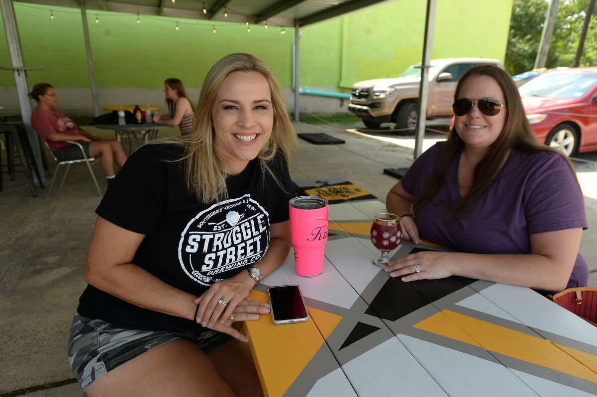 Kristin Reeves and Niki Broussard were at Struggle Street Brewing Company on the first day of bars reopening throughout the state. Owner Scott Reeves says a supportive customer base helped them do as well as possible while closed during the COVID-19 restrictions. Many stopped to pick up growlers and cans to go. Still, he says, gettinng open, even at the starting level of 25% is welcome.
