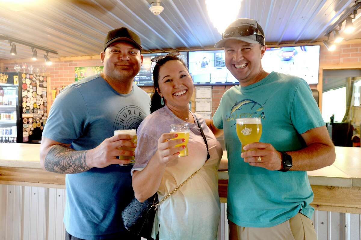 """Dale Dietz, Baily Perry and Brandon Perry were at Struggle Street Brewing Company on the first day of bars reopening throughout the state. Owner Scott Reeves says a supportive customer base helped them do as well as possible while closed during the COVID-19 restrictions. Many stopped to pick up growlers and cans to go. Still, he says, gettinng open, even at the starting level of 25% is welcome. """"We get so many regulars, and they become our best friends, so it's great to be able to hang out again. Reeves says all employees have their temperatures checked before coming in, and their newly opened patio area will allow for greater social distancing. Sanitizing stations are in place throughout, and the barstools have been removed. """"We're just trying to do the best we can, and hopefully we can get back up to 100% in a couple weeks."""" Photo taken Friday, May 22, 2020 Kim Brent/The Enterprise"""