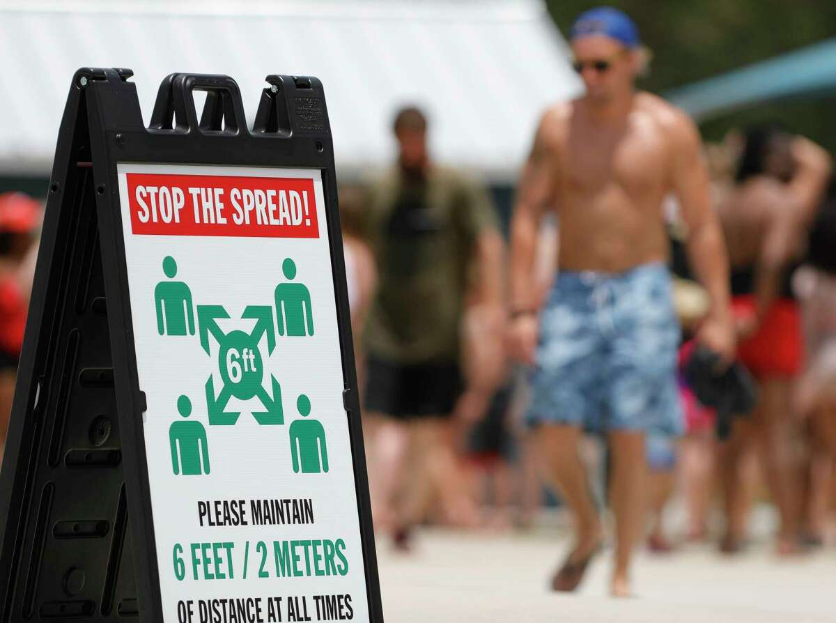 A sign urges guest to stay six feet apart at Big Rivers Waterpark, Saturday, May 23, 2020, in New Caney. The waterpark open for the season following Gov. Greg Abbott's start of Phase 2 reopening of the economy that began Friday.