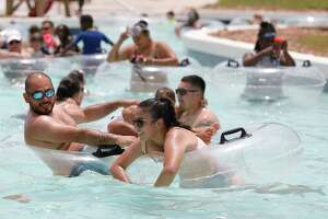 Guest float along the lazy river at Big Rivers Waterpark, Saturday, May 23, 2020, in New Caney. The waterpark open for the season following Gov. Greg Abbott's start of Phase 2 reopening of the economy that began Friday.